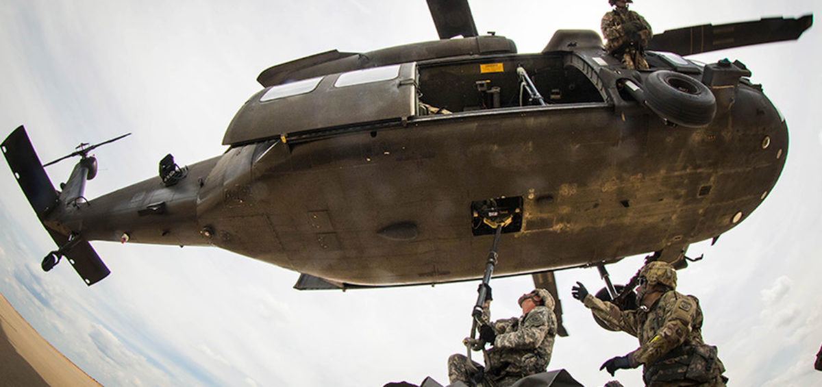 Soldiers with the 407th Brigade Support Battalion, 2nd Brigade Combat Team, attach a sling-load to the belly of a UH-60 Black Hawk assigned to the 82nd Combat Aviation Brigade, during a sling load training event at Holland Drop Zone on Fort Bragg, N.C., Aug. 24, 2016. (U.S. Army Photo by Capt. Adan Cazarez)